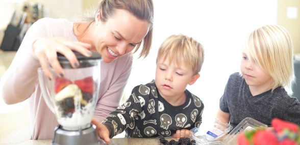 family making a smoothie