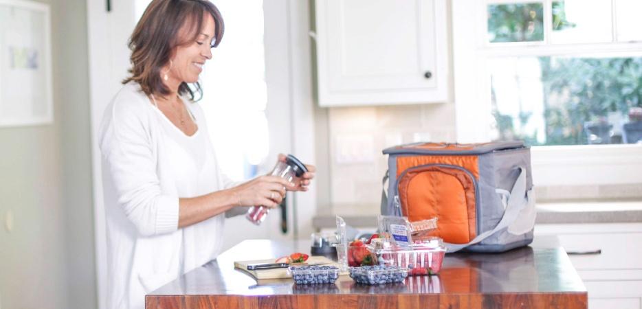 woman preparing a berry snack